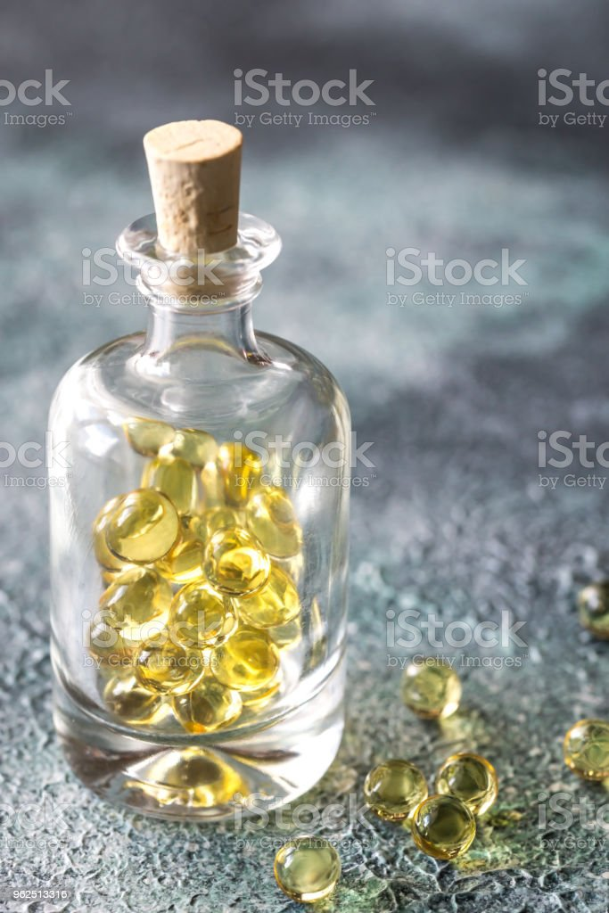 Omega-3 fish oil capsules in the glass bottle - Royalty-free Acid Stock Photo