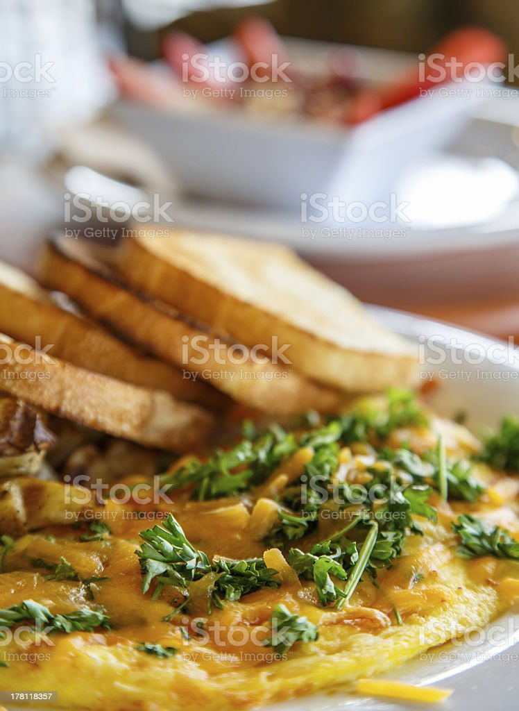 Omelet and Toast with Oatmeal in Background royalty-free stock photo