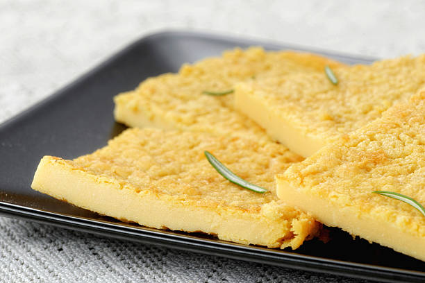 Omelette Omelette on a black dish farinata stock pictures, royalty-free photos & images