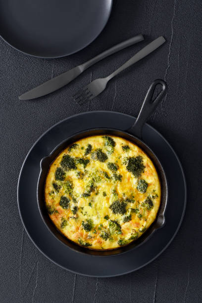 Omelet with broccoli and cheddar cheese stock photo
