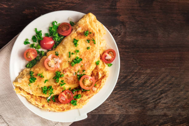 Omelet with parsley, cherry tomatoes, and copyspace stock photo