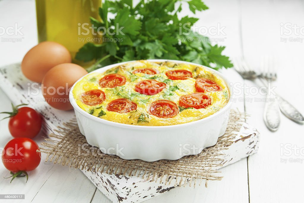 Omelet with vegetables and cheese. Frittata stock photo