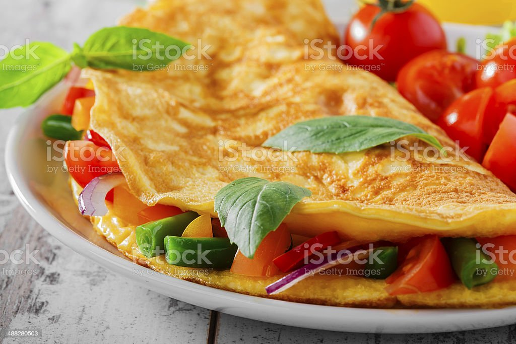 omelet with vegetables and cherry tomatoes stock photo