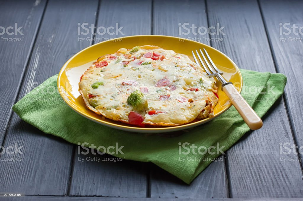 omelette from chicken eggs with cheese, fresh vegetables - cucumber and tomato stock photo