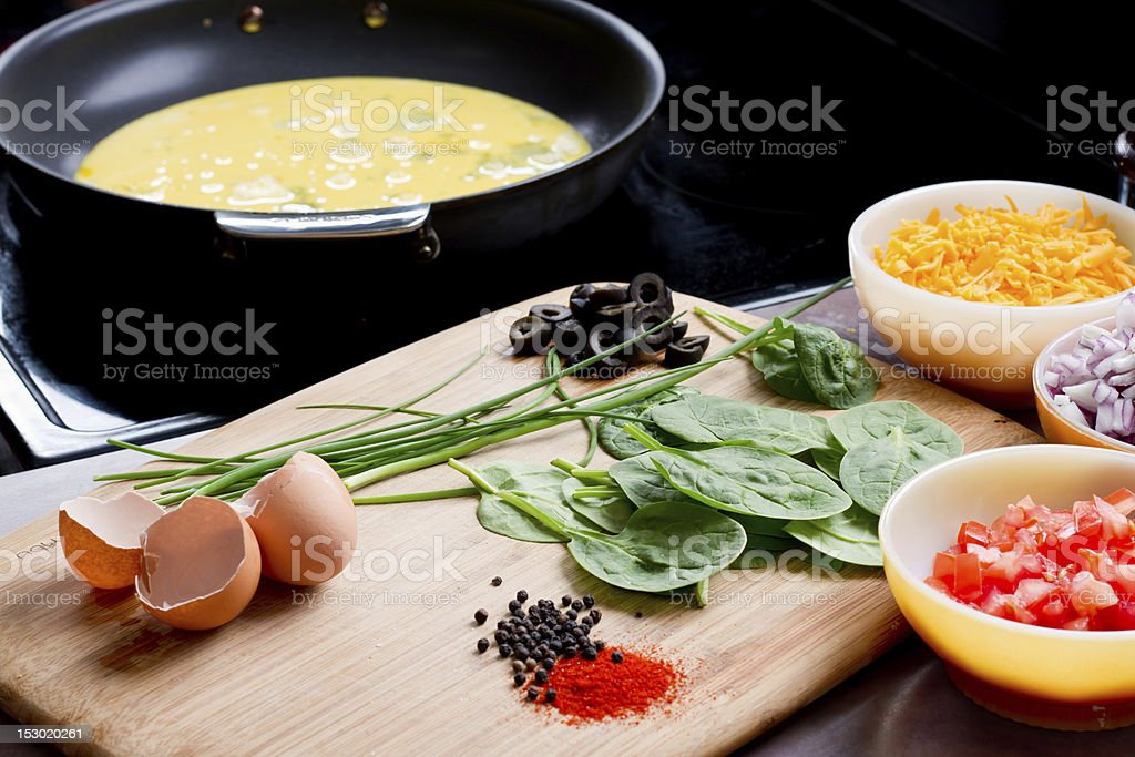 Omelette Ingredients by Stovetop royalty-free stock photo