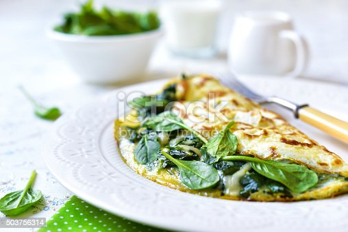 Omelette stuffed with spinach and cheese for a breakfast.
