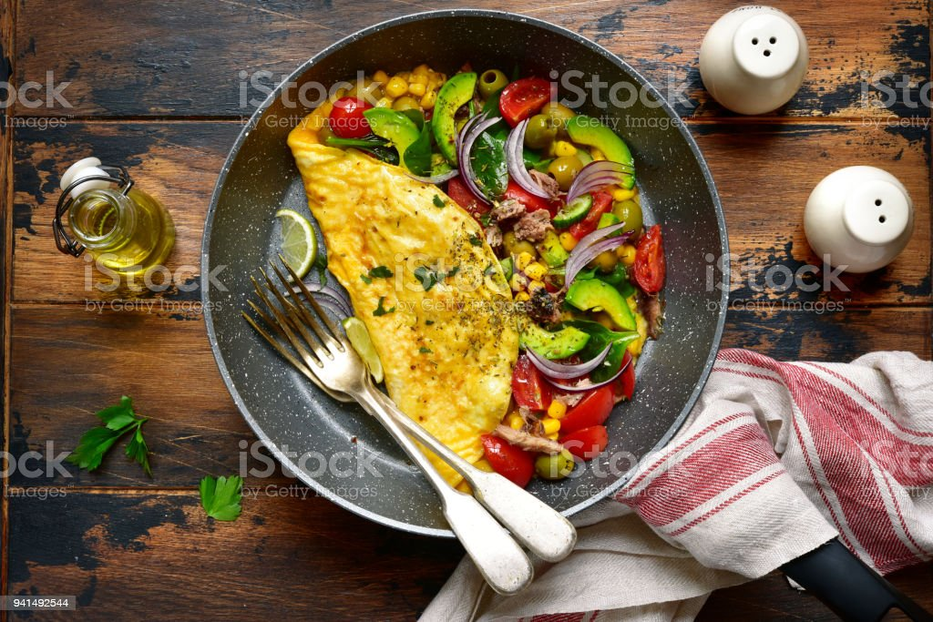 Omelette stuffed with vegetables stock photo