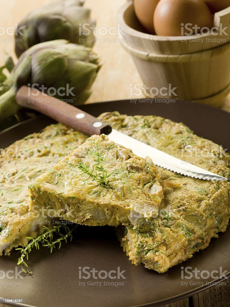omelette with artichokes and knife royalty-free stock photo