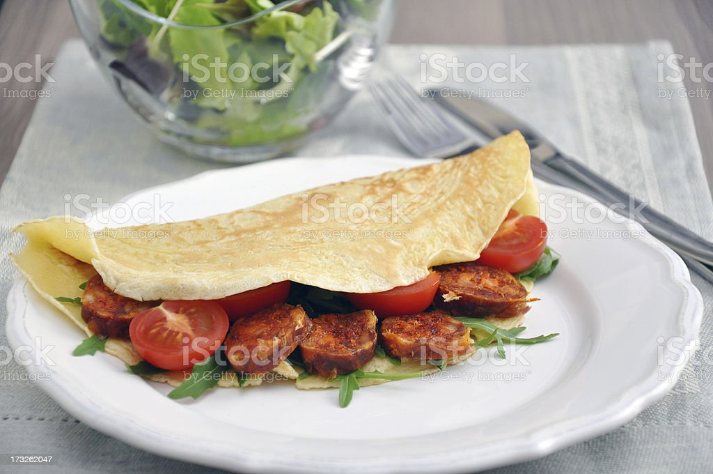 omelette with chorizo and herbs stock photo