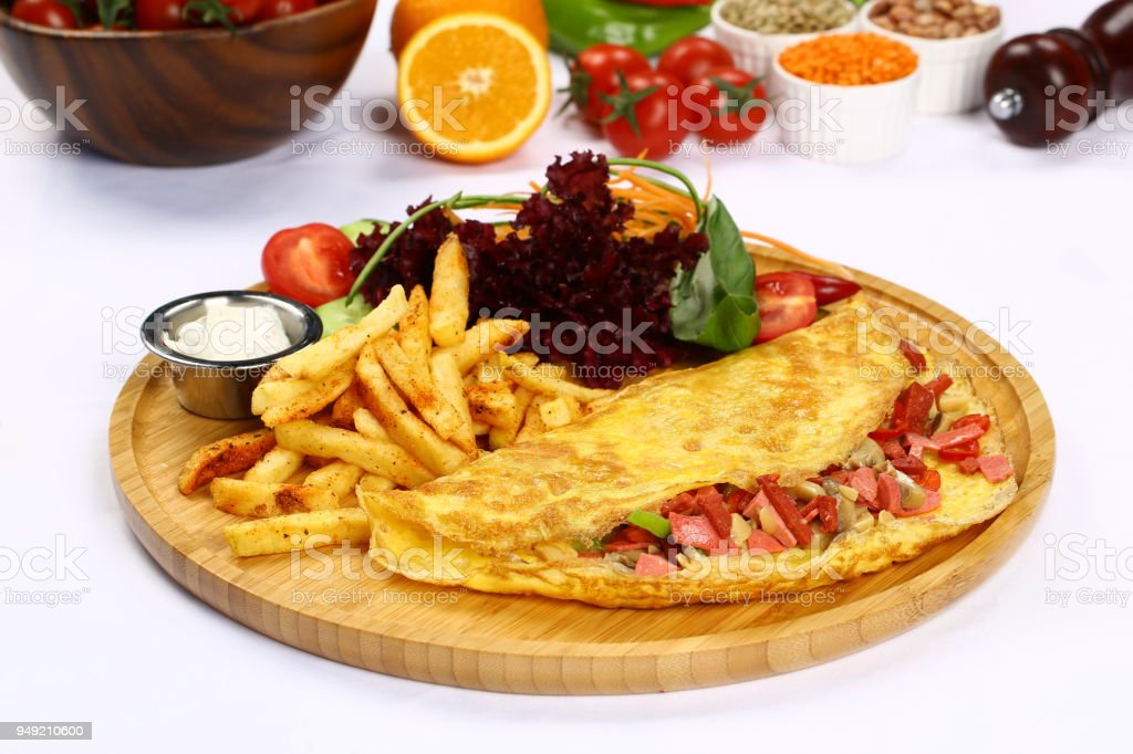 Omelette with ham and sausage stock photo