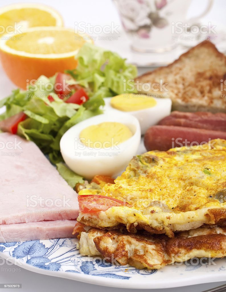omelette with ham, bacon and vegetables close up royalty-free stock photo