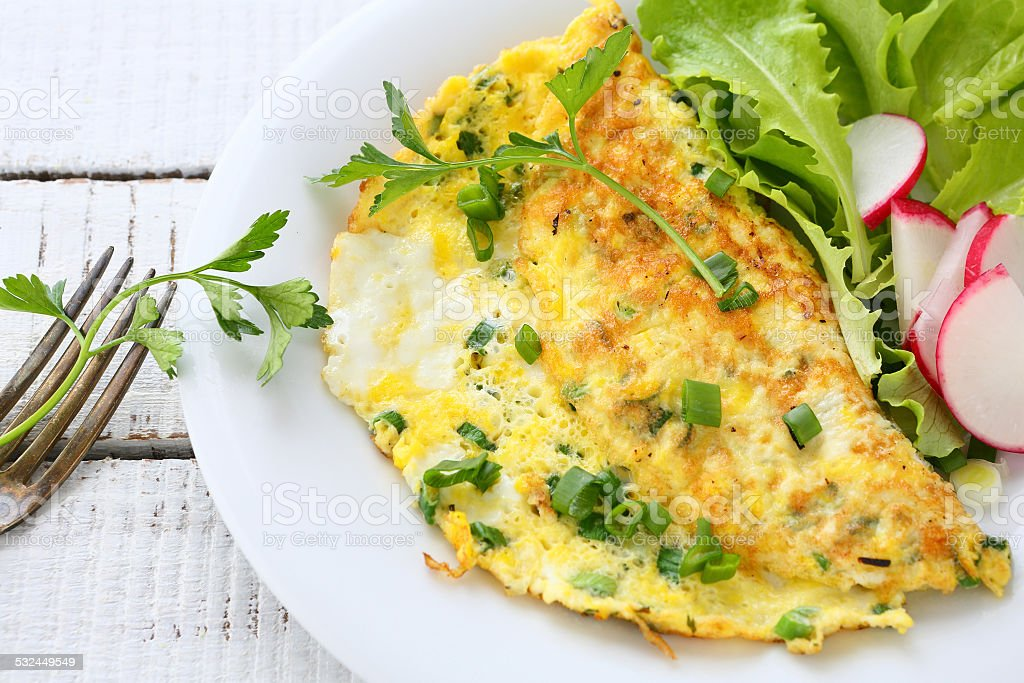 Omelette with radishes, onions and lettuce Omelette with radishes, onions and lettuce, food 2015 Stock Photo