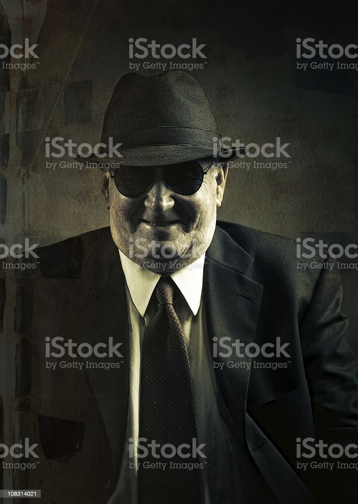 omerta boss with a sinister laugh stock photo