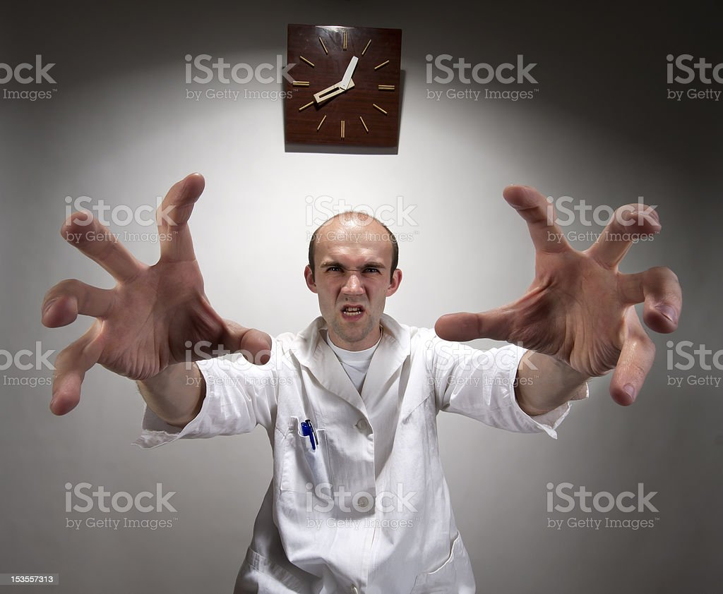 Ominous angry doctor stock photo
