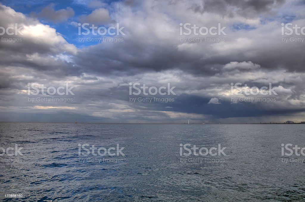 Ominous Clouds Over A Lake royalty-free stock photo