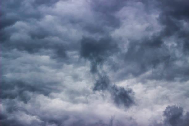 Ominous dark clouds stock photo