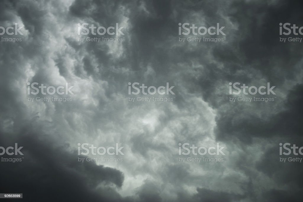 Ominous dark gray storm clouds covering the sky royalty-free stock photo