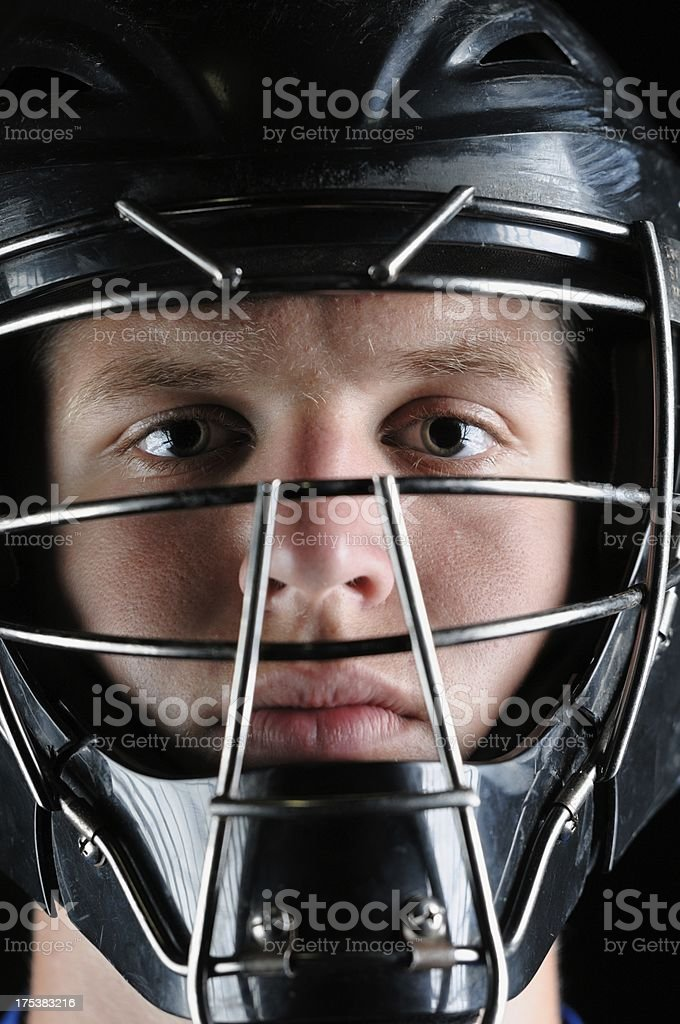 Ominous looking baseball catcher stock photo