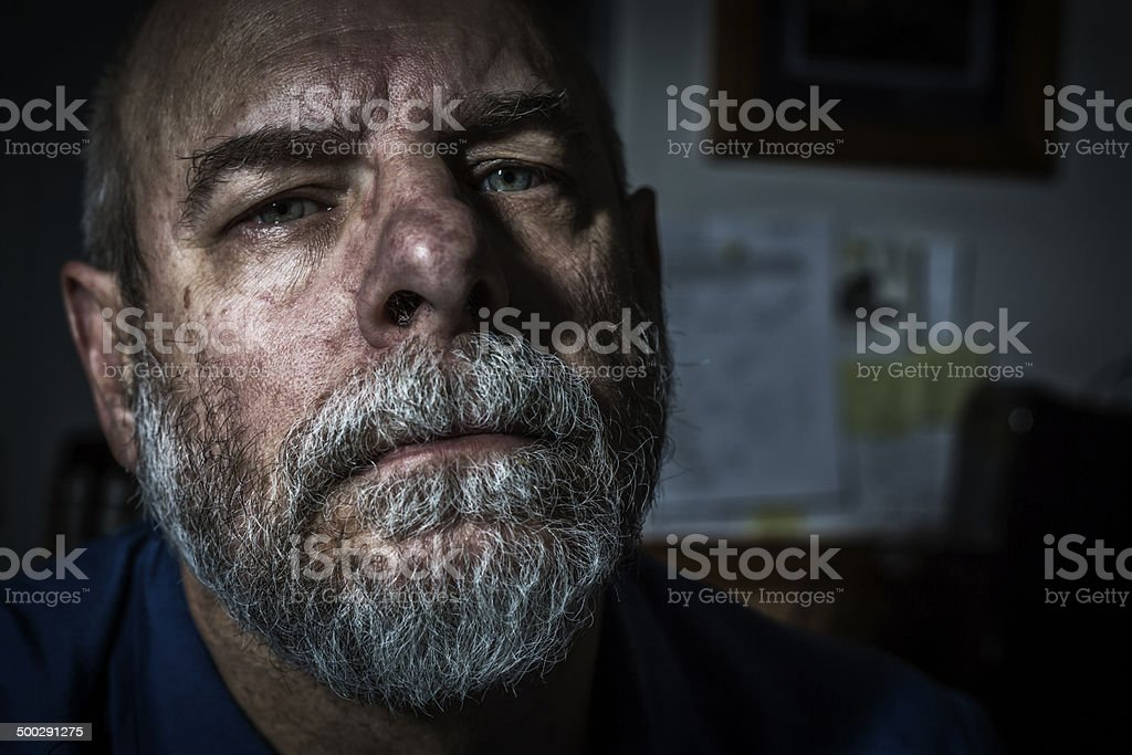 Ominous Man Close-Up Mug Shot stock photo