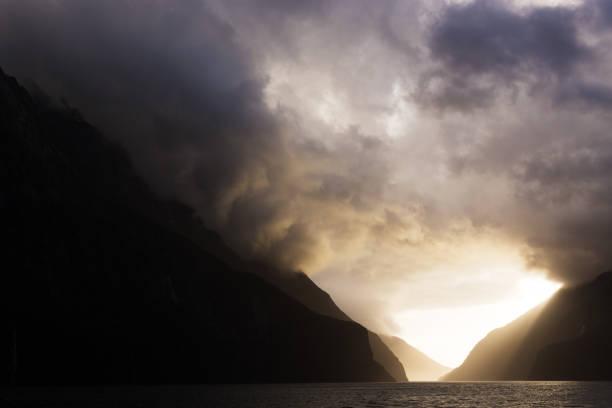 Ominous, stormy layered mountain pass stock photo