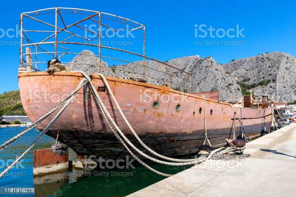 Omis. Old rusty ship near the pier.