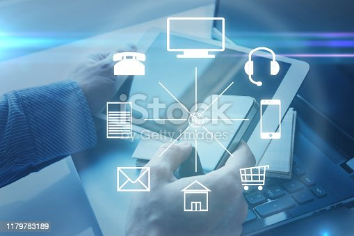Hands with a tablet and different icons around. Omni channel