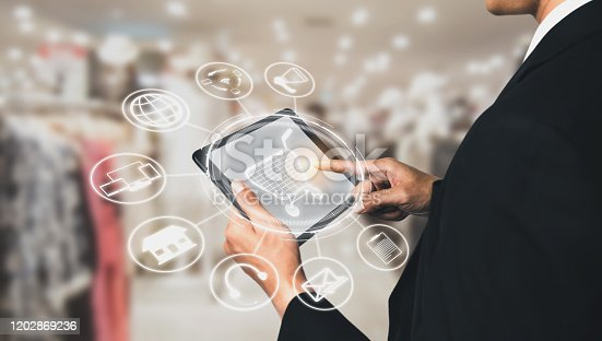654078994 istock photo Omni channel technology of online retail business. 1202869236