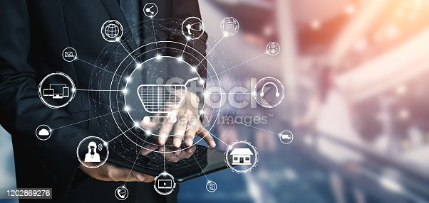 654078994 istock photo Omni channel technology of online retail business. 1202869276