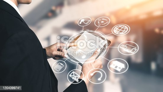 938918098 istock photo Omni channel technology of online retail business. 1204099741