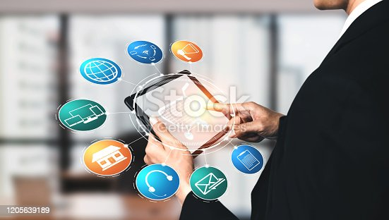 1025744816 istock photo Omni channel technology of online retail business. 1205639189