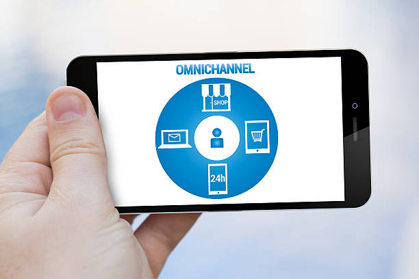 omnichannel cell phone - omnichannel marketing stock photos and pictures