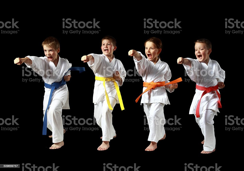 On a black background four sportsmen are beating punch hand stock photo