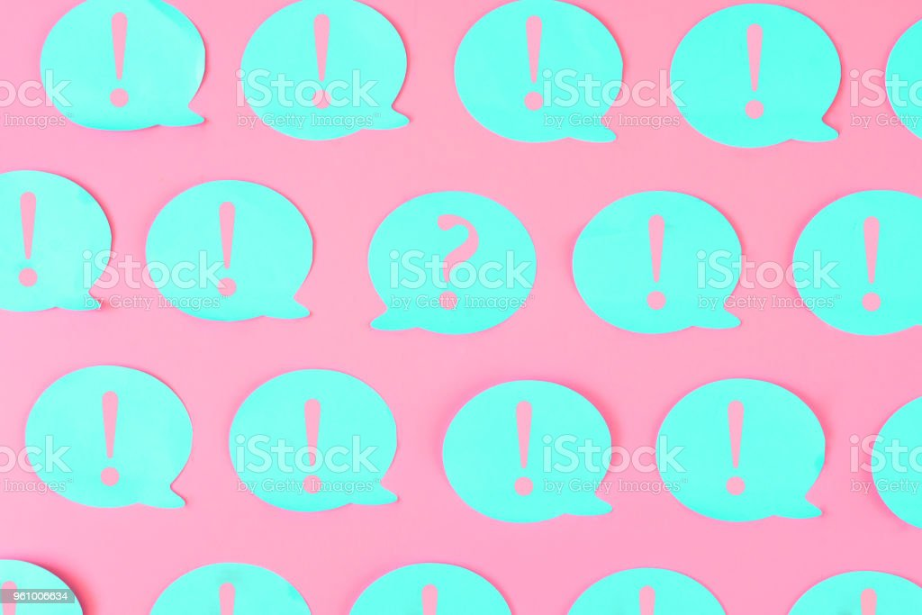 on a bright background are glued blue stickers with pink exclamation marks in the center