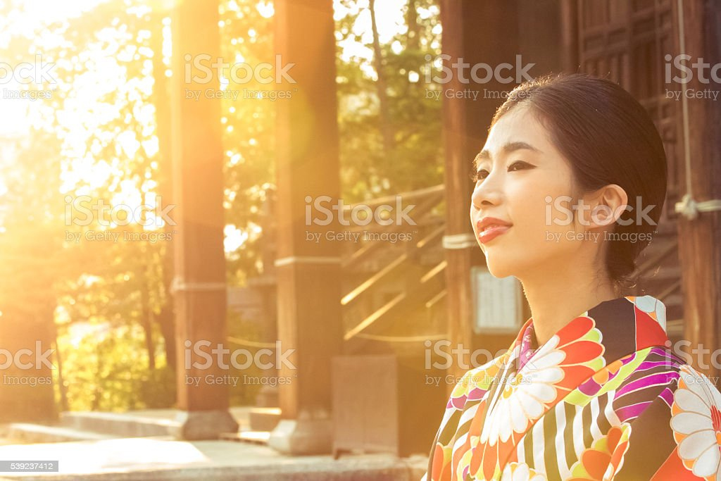 On a bright summer day, a Japanese girl visiting temple. royalty-free stock photo