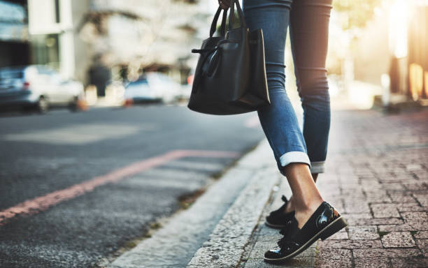 On a business mission Closeup shot of a businesswoman walking with her handbag in the city human foot stock pictures, royalty-free photos & images