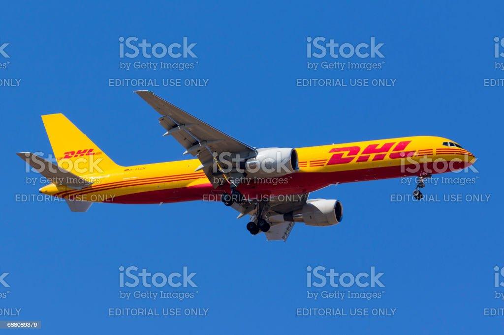 DHL 757 on a clear blue sky