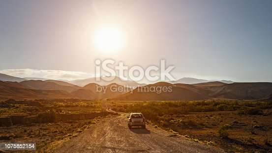 istock SUV on a dirt mountain road 1075852154