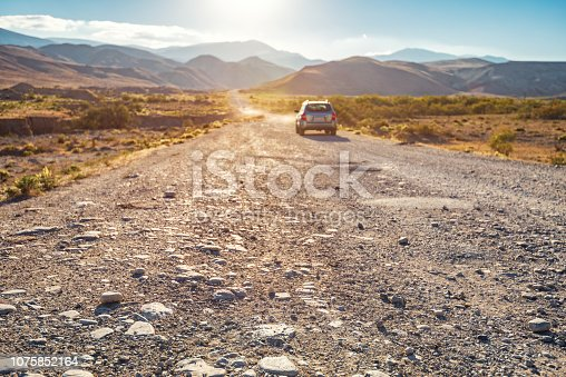 istock SUV on a dirt mountain road 1075852164