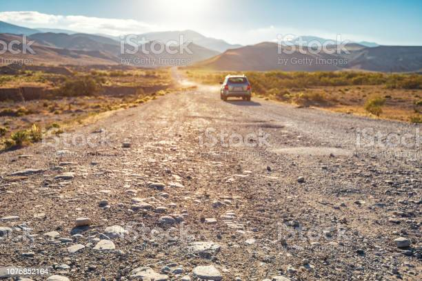 Photo of SUV on a dirt mountain road
