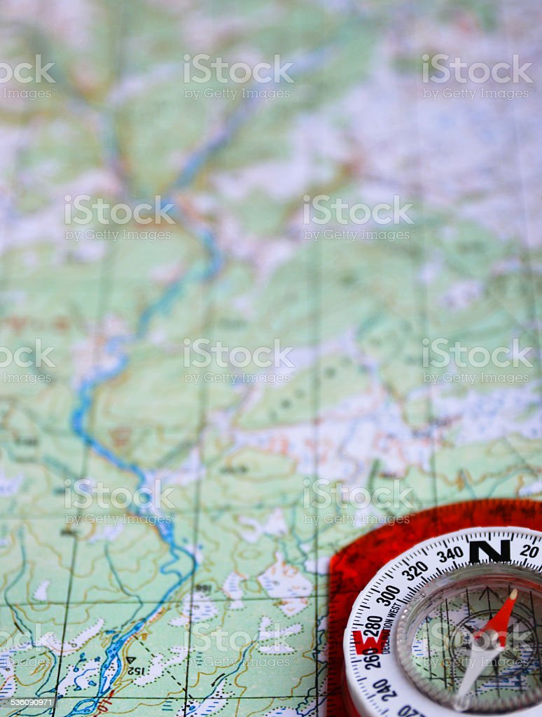 On a journey with map and compass. stock photo