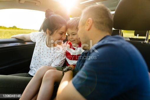 930810564 istock photo On a road trip with parents 1206045145