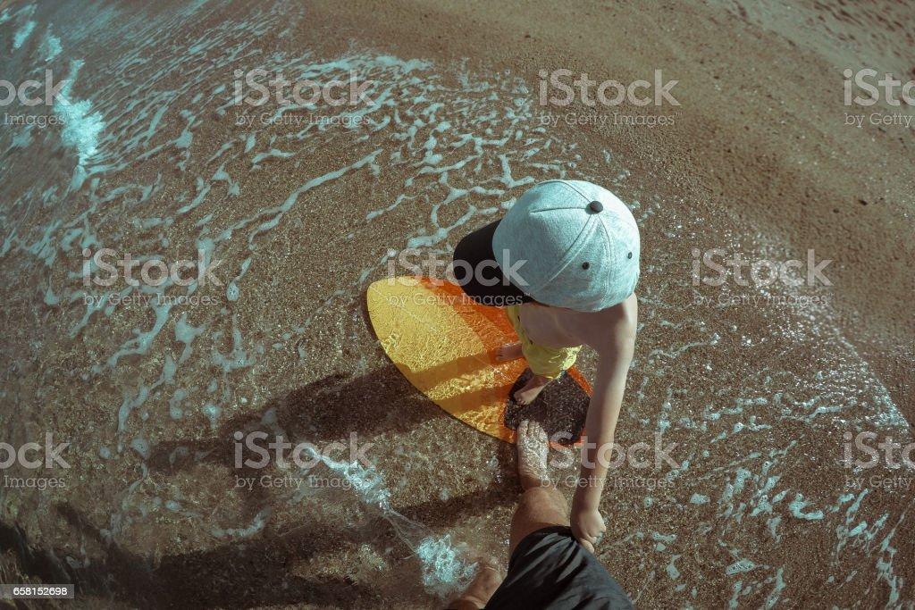 On a skimboard stock photo