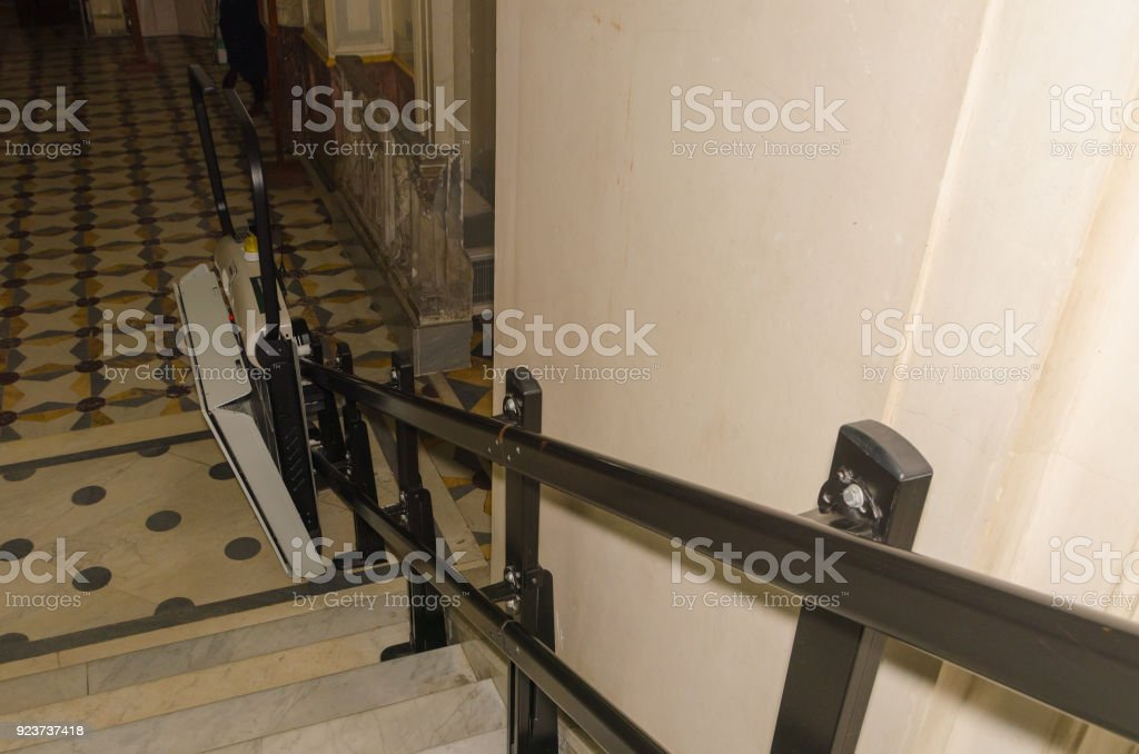 on  a transition to the stairs lift for disabled wheelchair users stock photo