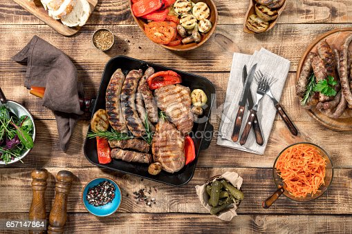 685404620istockphoto On a wooden table different food cooked on the grill 657147864