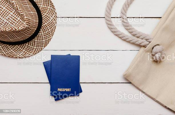 On a wooden table lies a hat a beach bag and two passports picture id1084293026?b=1&k=6&m=1084293026&s=612x612&h=rpjnqvgo3l0z mrl3vybsnr3il9hmr0ingf ovohz7c=