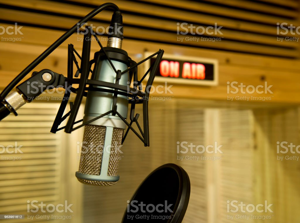 'On air' sign turns on and a microphone in the studio stock photo