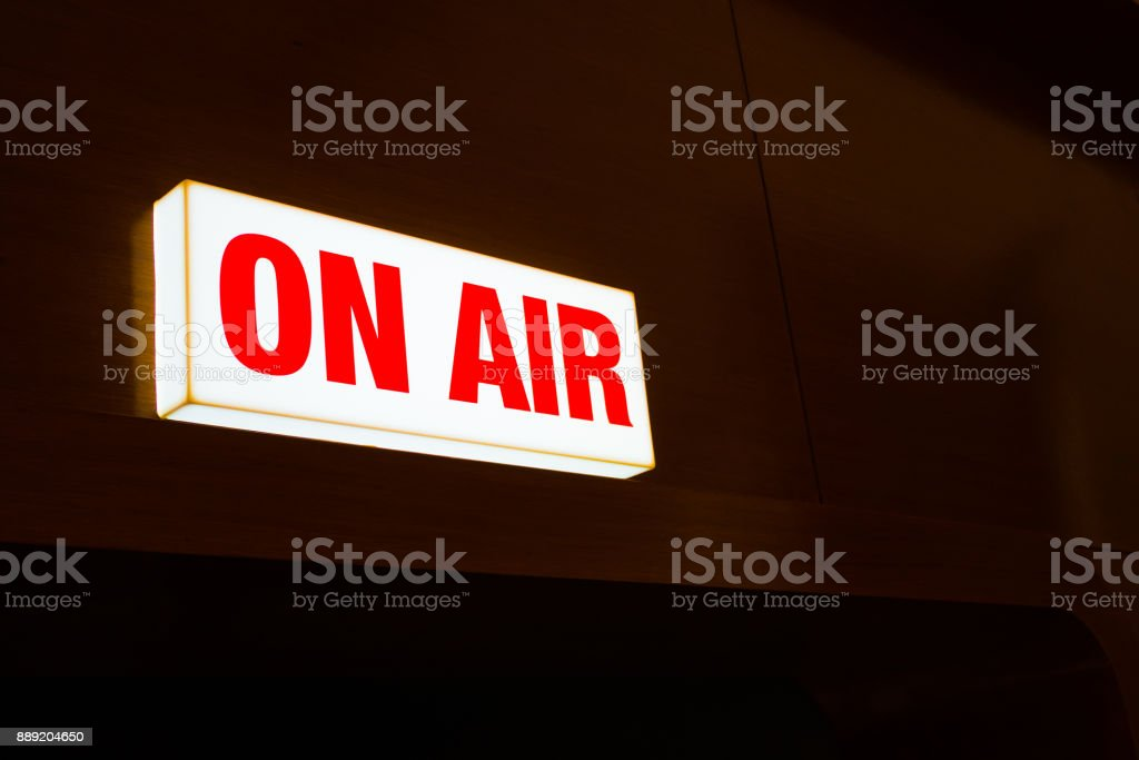 on air studio sign on light box and red alphabet live studio concept