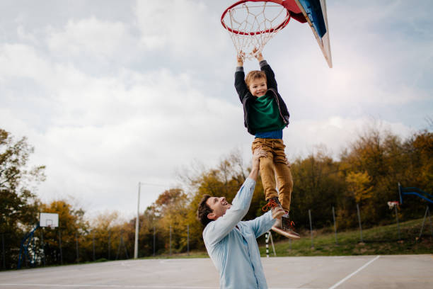 on basketball court with my dad - game of life stock photos and pictures