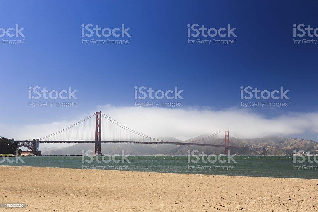 On beach San Francisco looking at the Golden Gate Bridge royalty-free stock photo