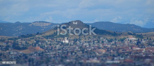 """In the spring of 1910, the """"M"""" was constructed on 6310-foot Big Butte in Butte, Montana. This image shows the city of Butte, Montana situated below the Big"""